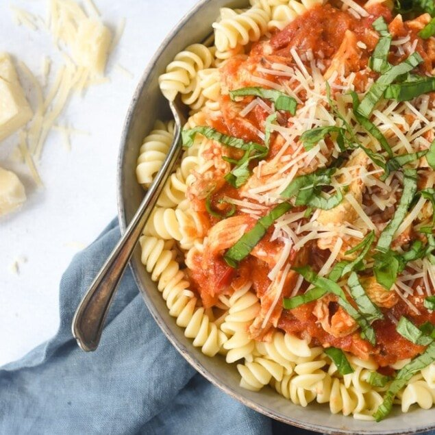 CHicken and Tomato Pasta in a bowl with a fork
