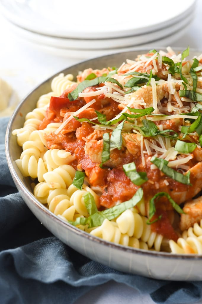 Chicken and fresh tomatoes over pasta