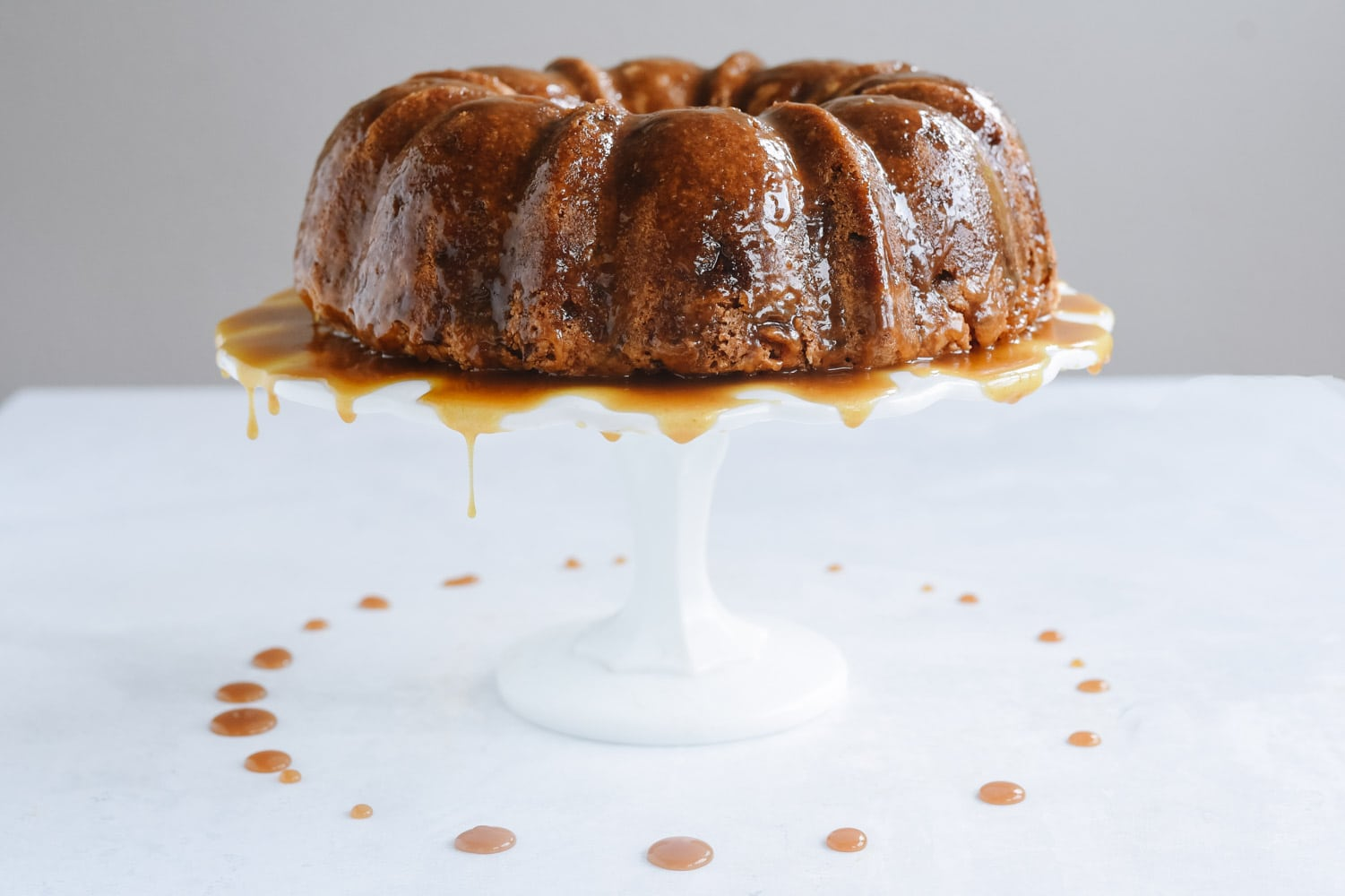 Apple Bundt Cake on a cake stand
