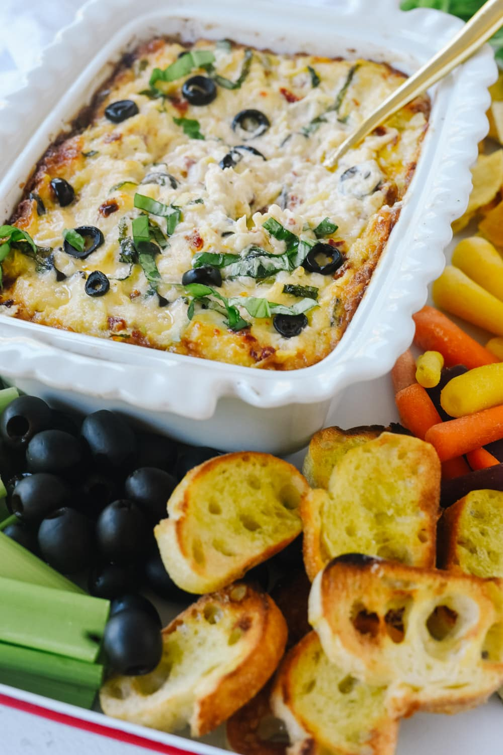 hot olive artichoke dip with bread