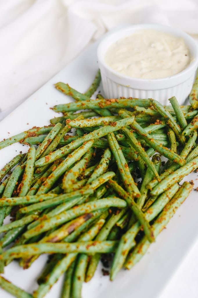 seared green beans on a plate