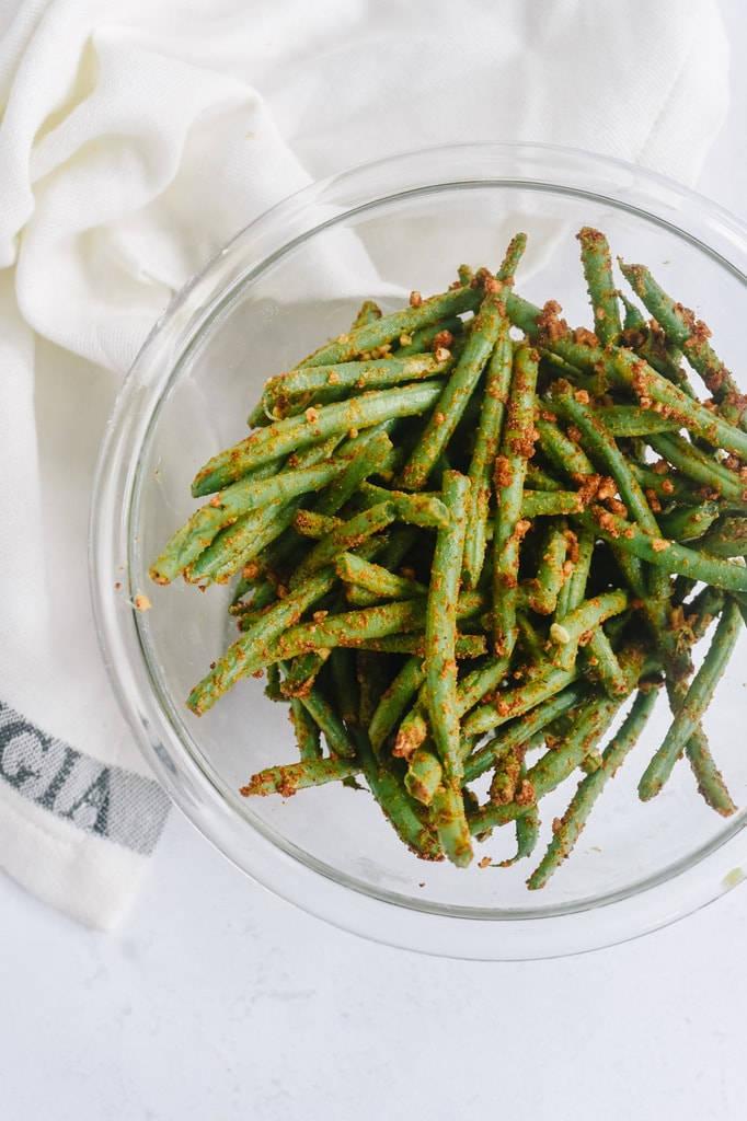 green beans with seasoning on them.