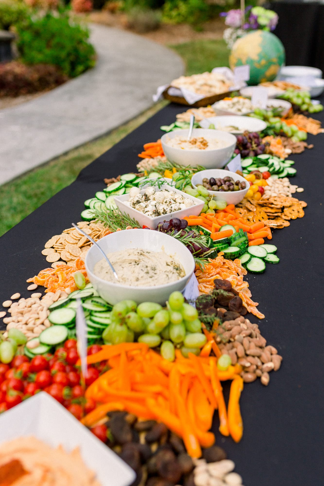 a wedding grazing table with hummus