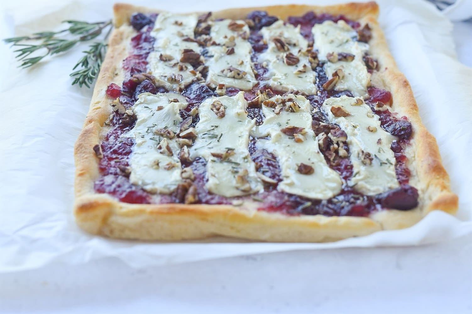 baked cranberry brie on parchment paper