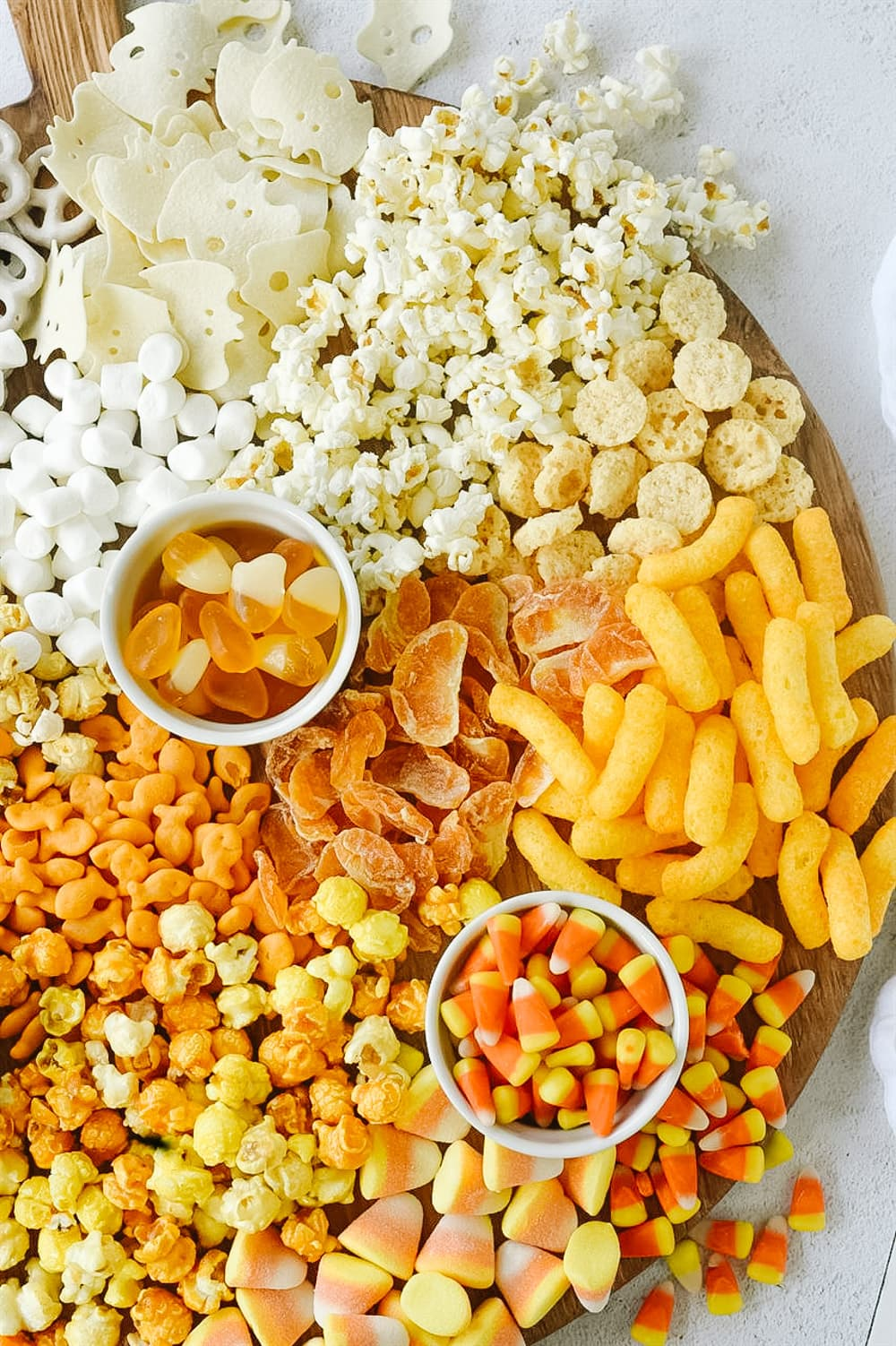 candy corn snack board with popcorn