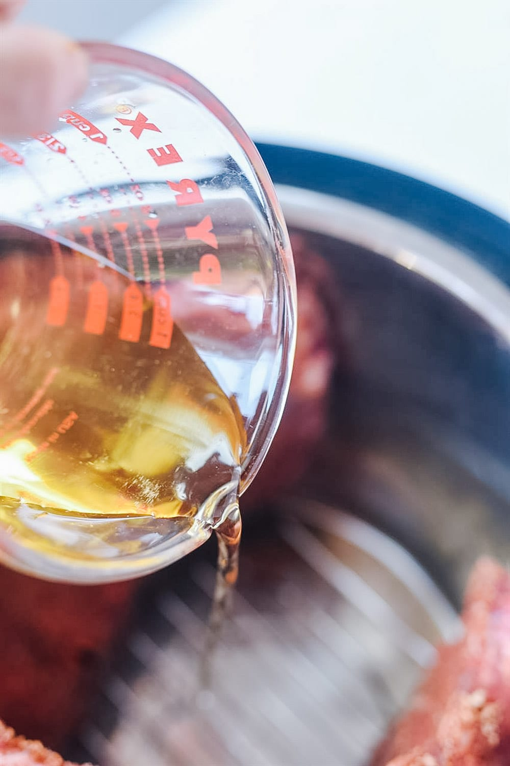 pouring apple juice into the instant pot