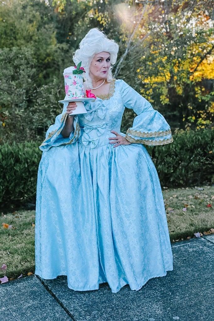 Marie Antoinette holding cake