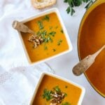 Two bowls of pumpkin vegetable soup