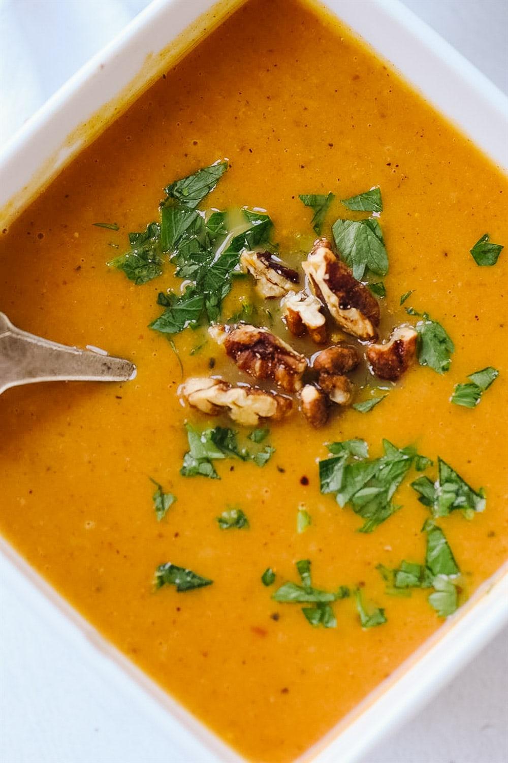 Single bowl of pumpkin vegetable soup