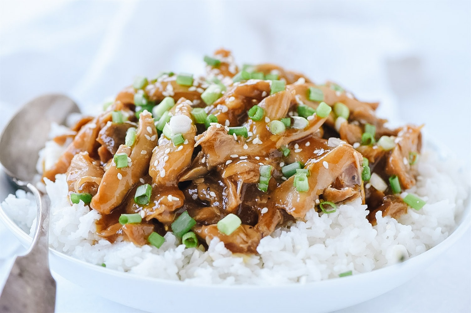 teriyaki chicken over rice in a bowl