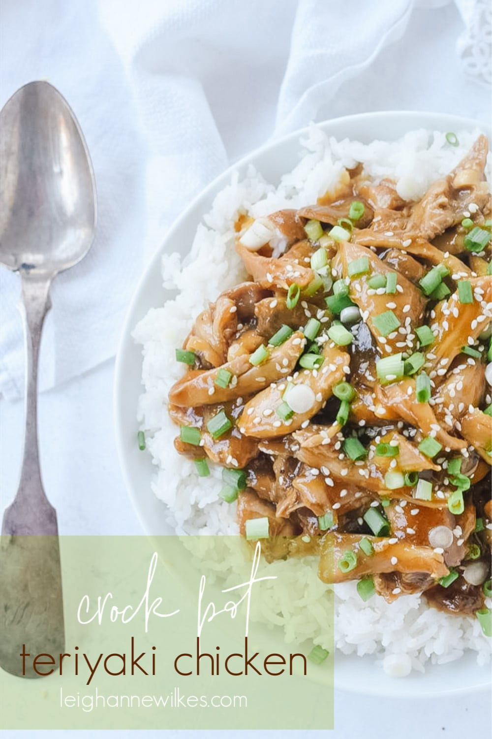 slow cooker teriyaki chicken in a bowl with a spoon