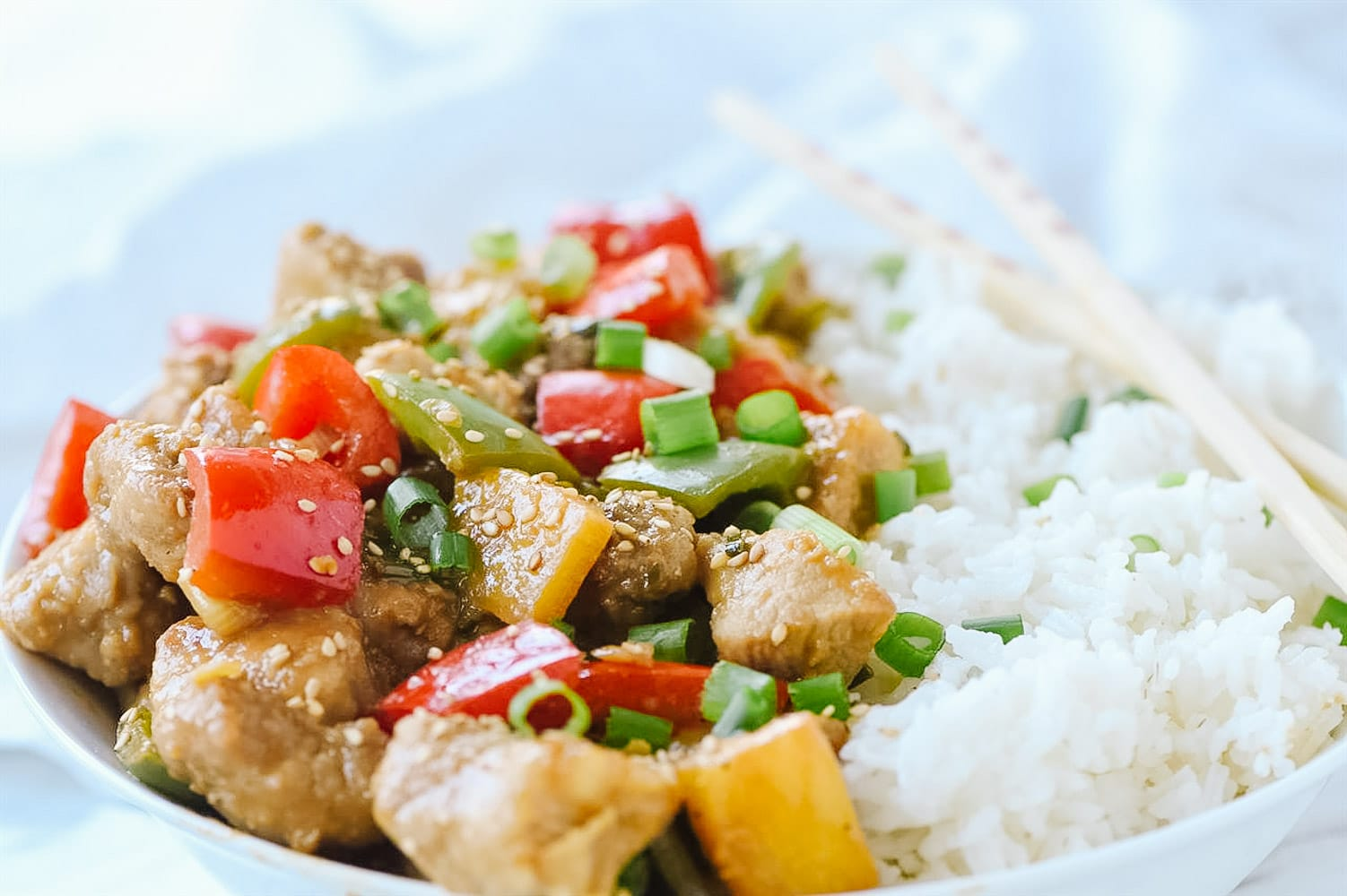 sweet and sour pork and rice in a bowl