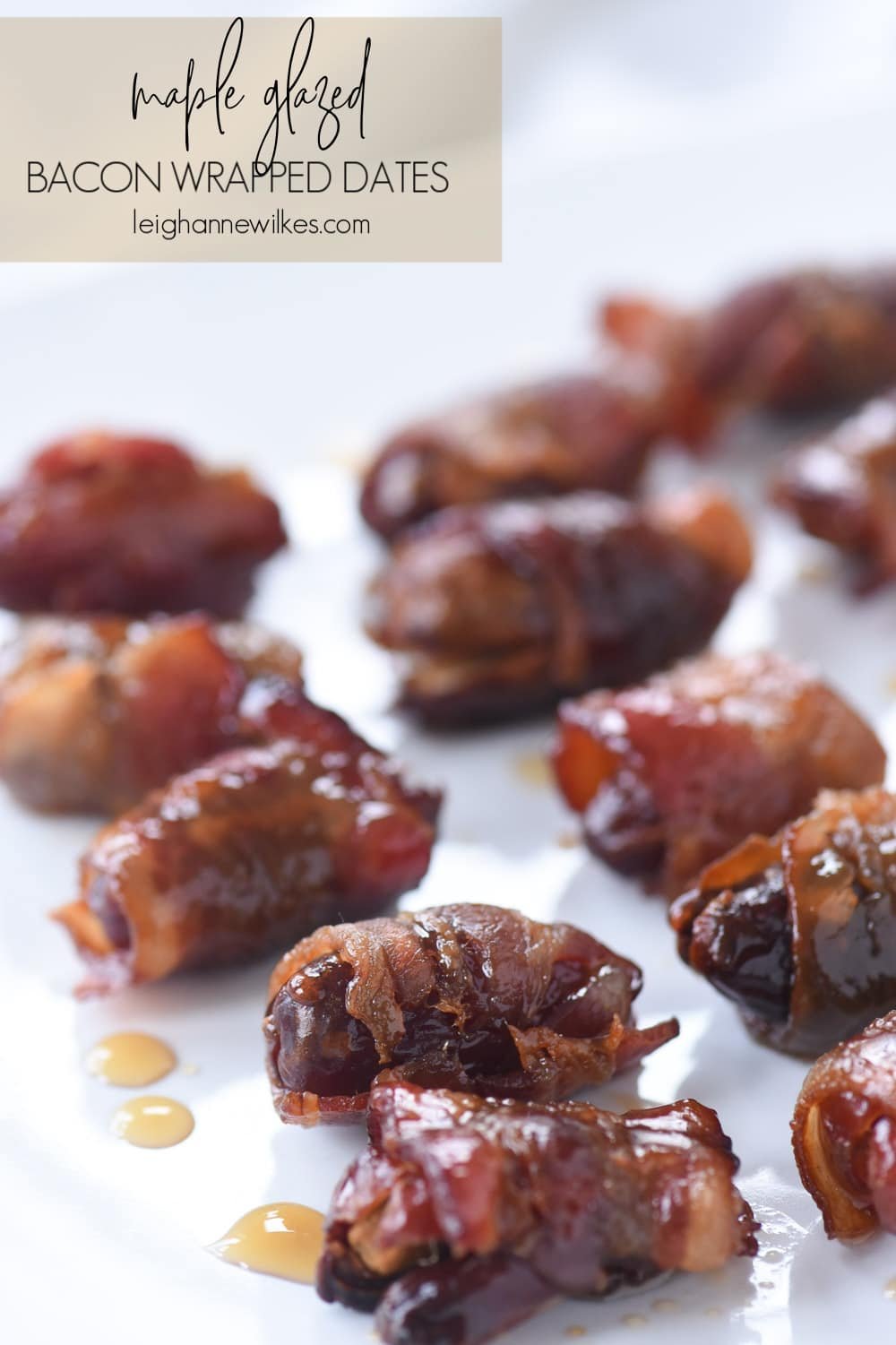 bacon wrapped dates on a plate