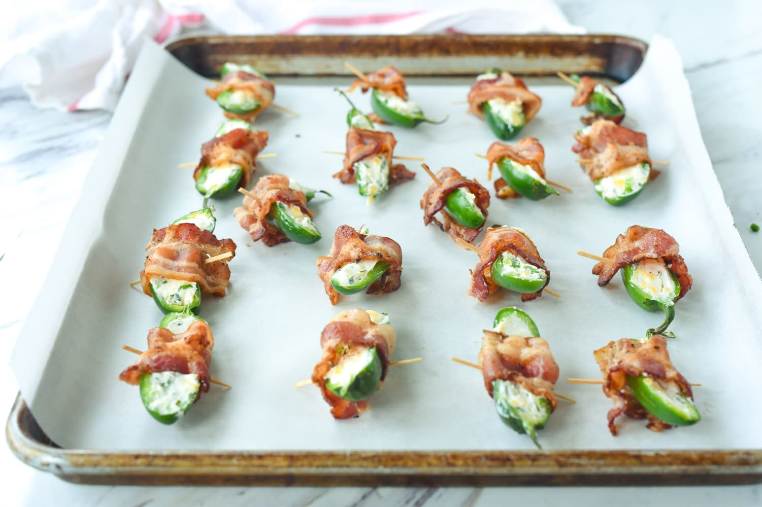 jalapeno poppers on a baking sheet