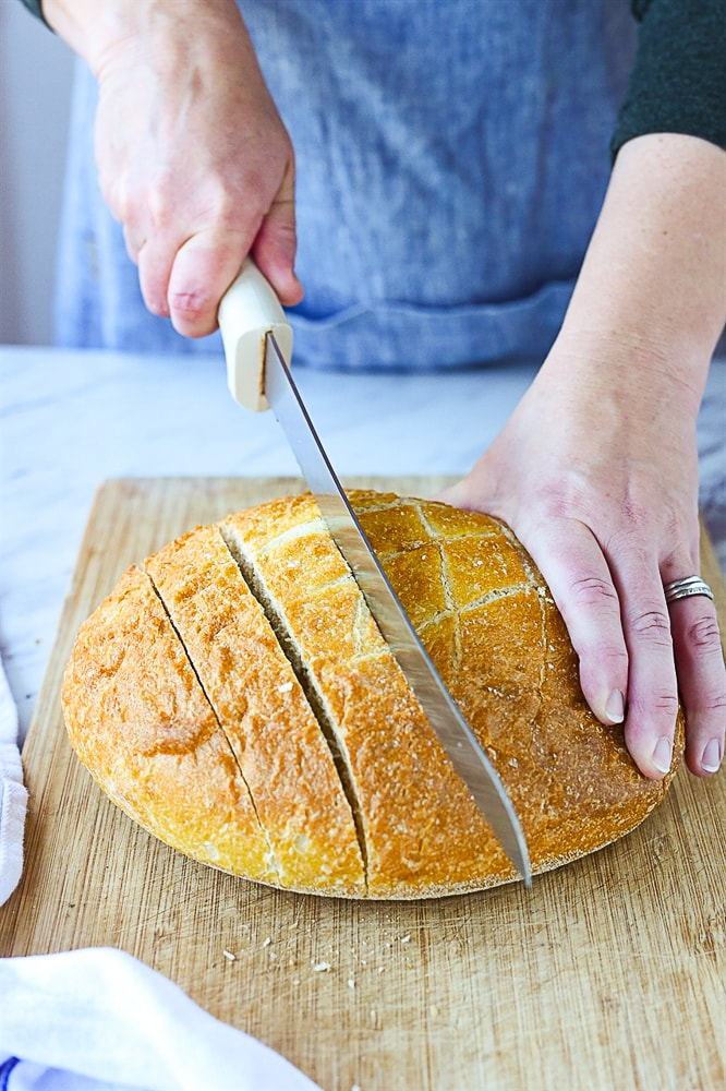 cutting a loaf of bread