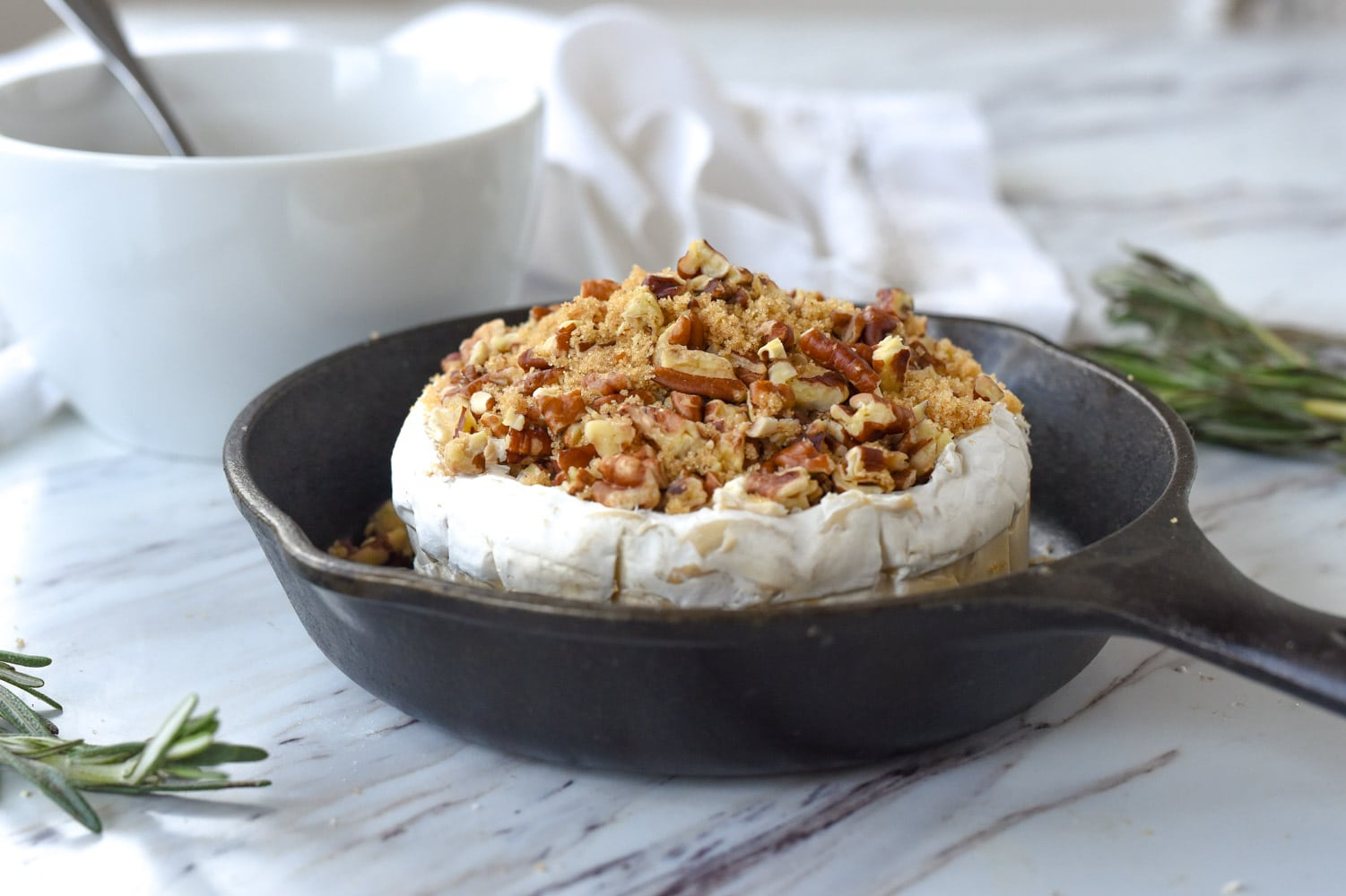 brie with brown sugar and pecans on top