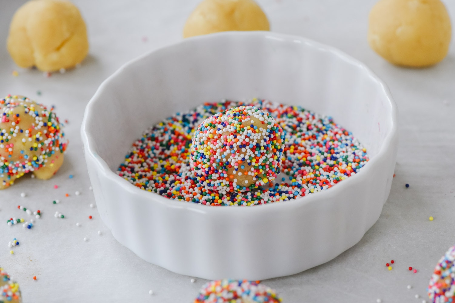 ball of sugar cookie dough with sprinkles