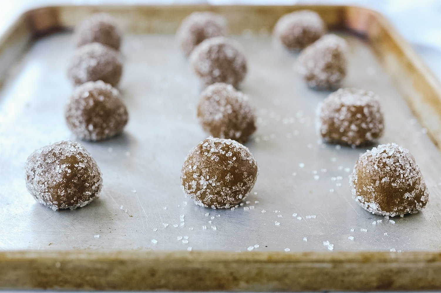 balls of gingersnap dough on baking sheet