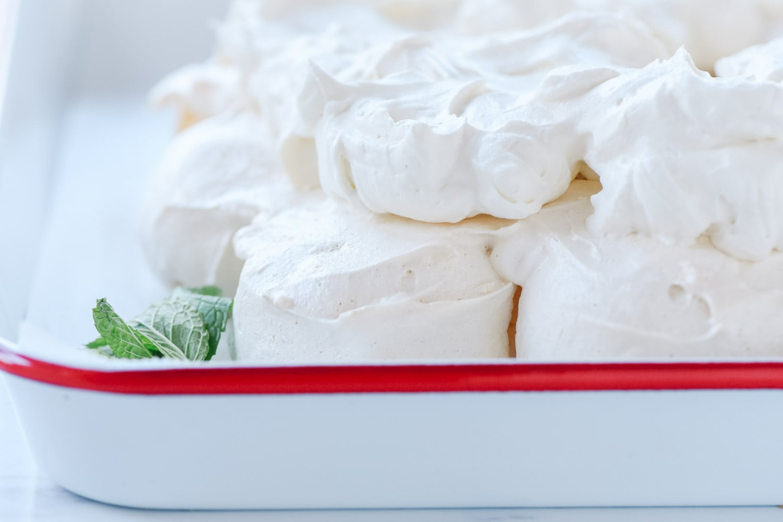 whipped cream on pavlova wreath