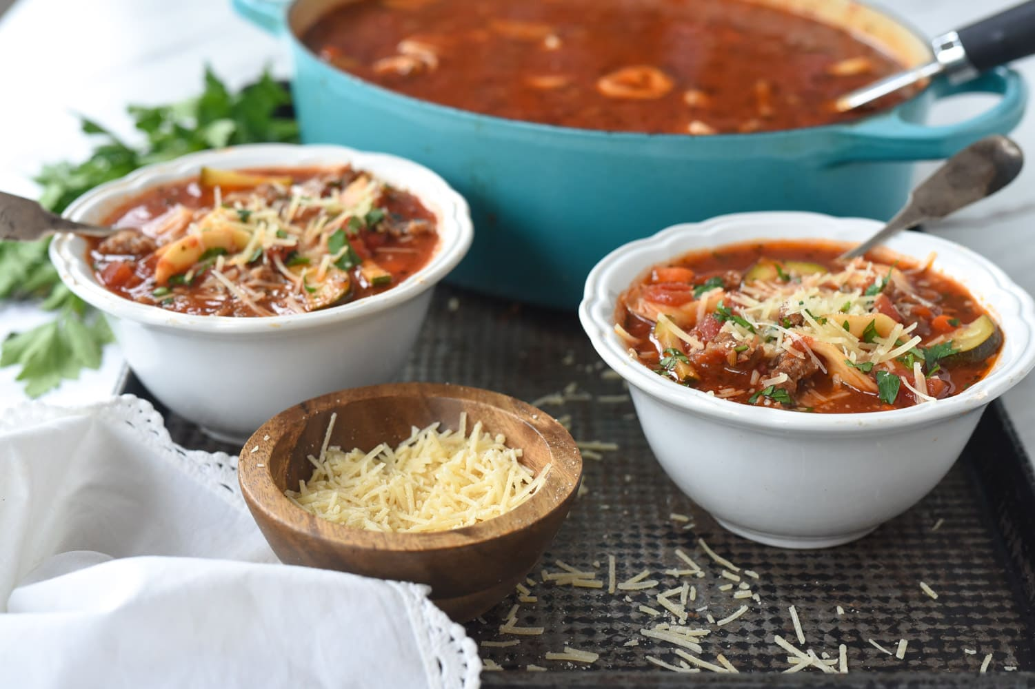 two bowls of sausage tortellini soup