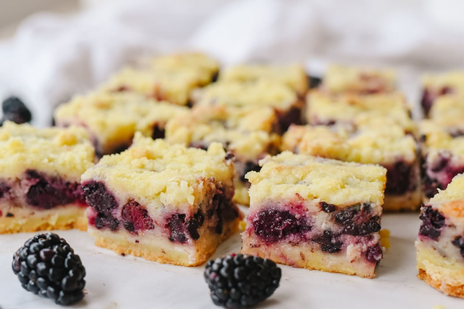 blackberry pie bars cut into squares