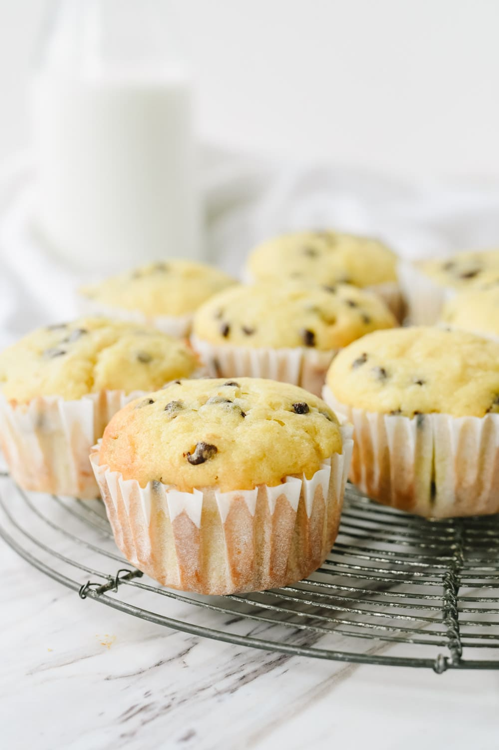 banana chocolate chip muffins on a rack