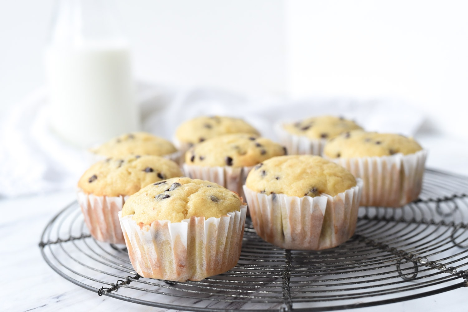 banana chocolate chip muffins on a cooling rack