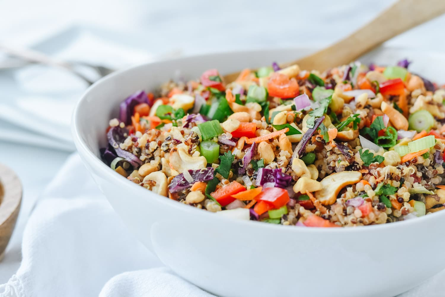 white bowl of thai quinoa salad