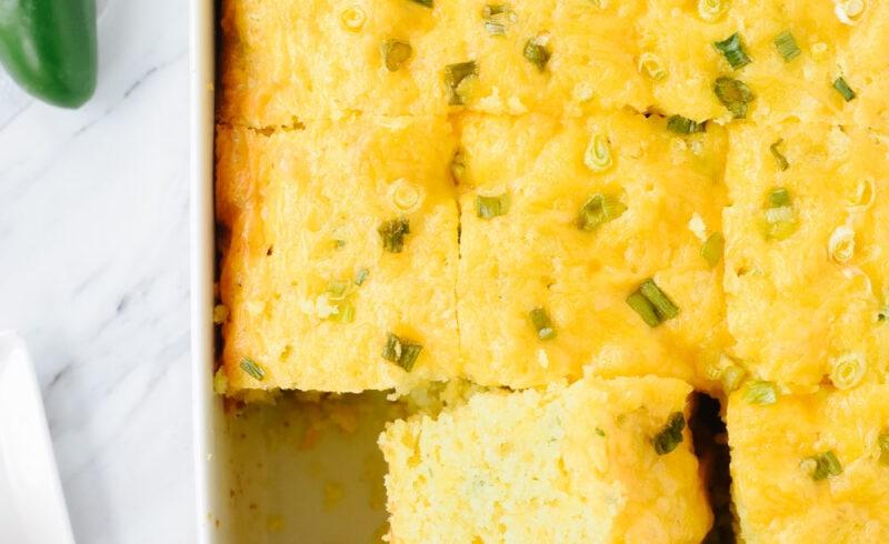 slice of jalapeno cornbread in a pan