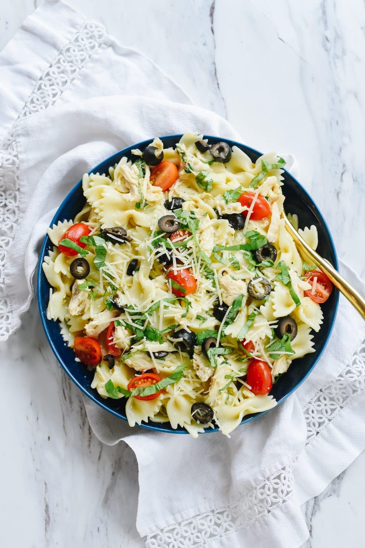 blue bowl of mediterranean chicken pasta