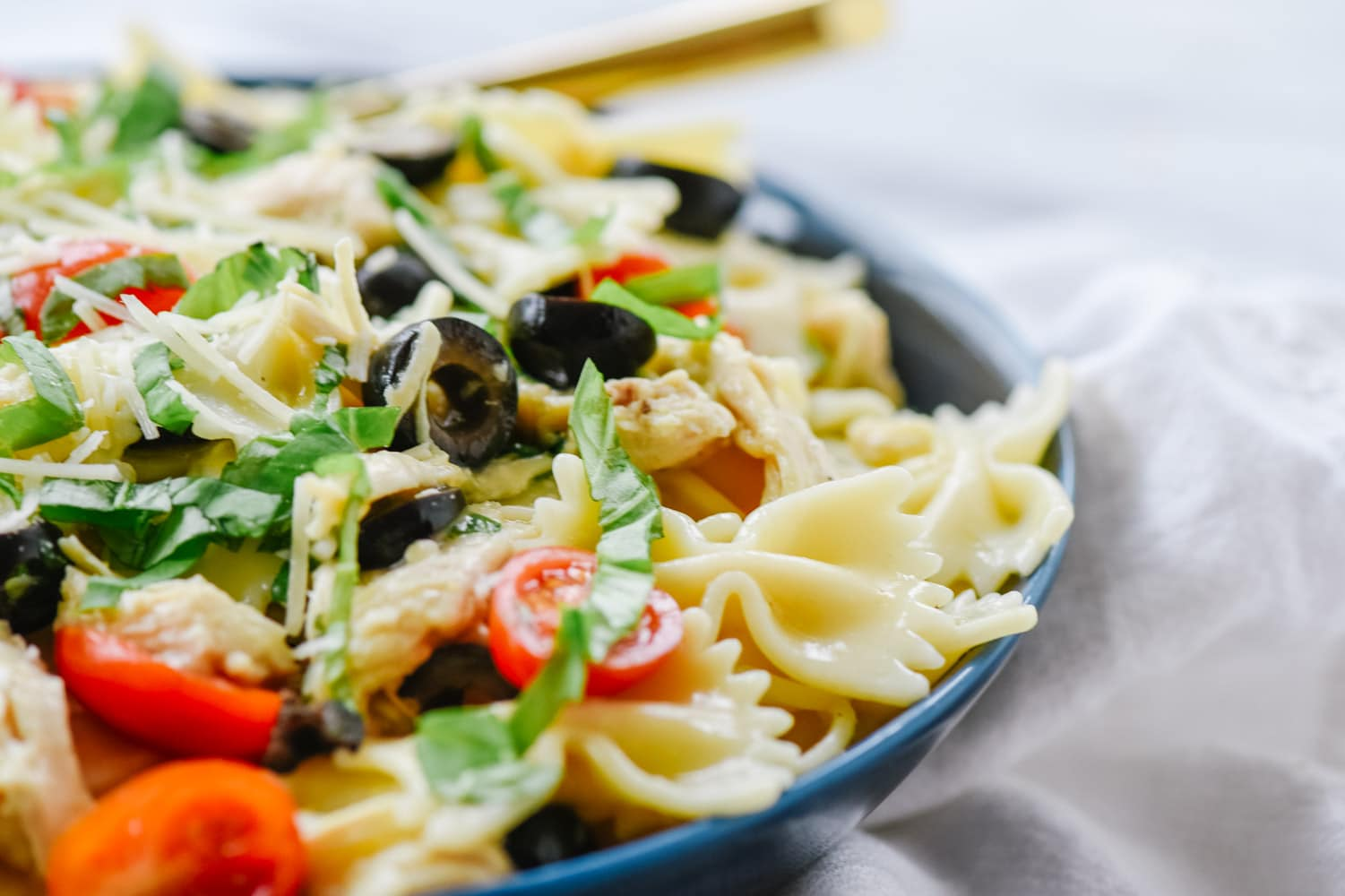 mediterranean pasta in a bowl with a fork