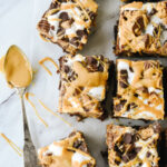 Peanut Butter Cheesecake brownies drizzled with peanut butter