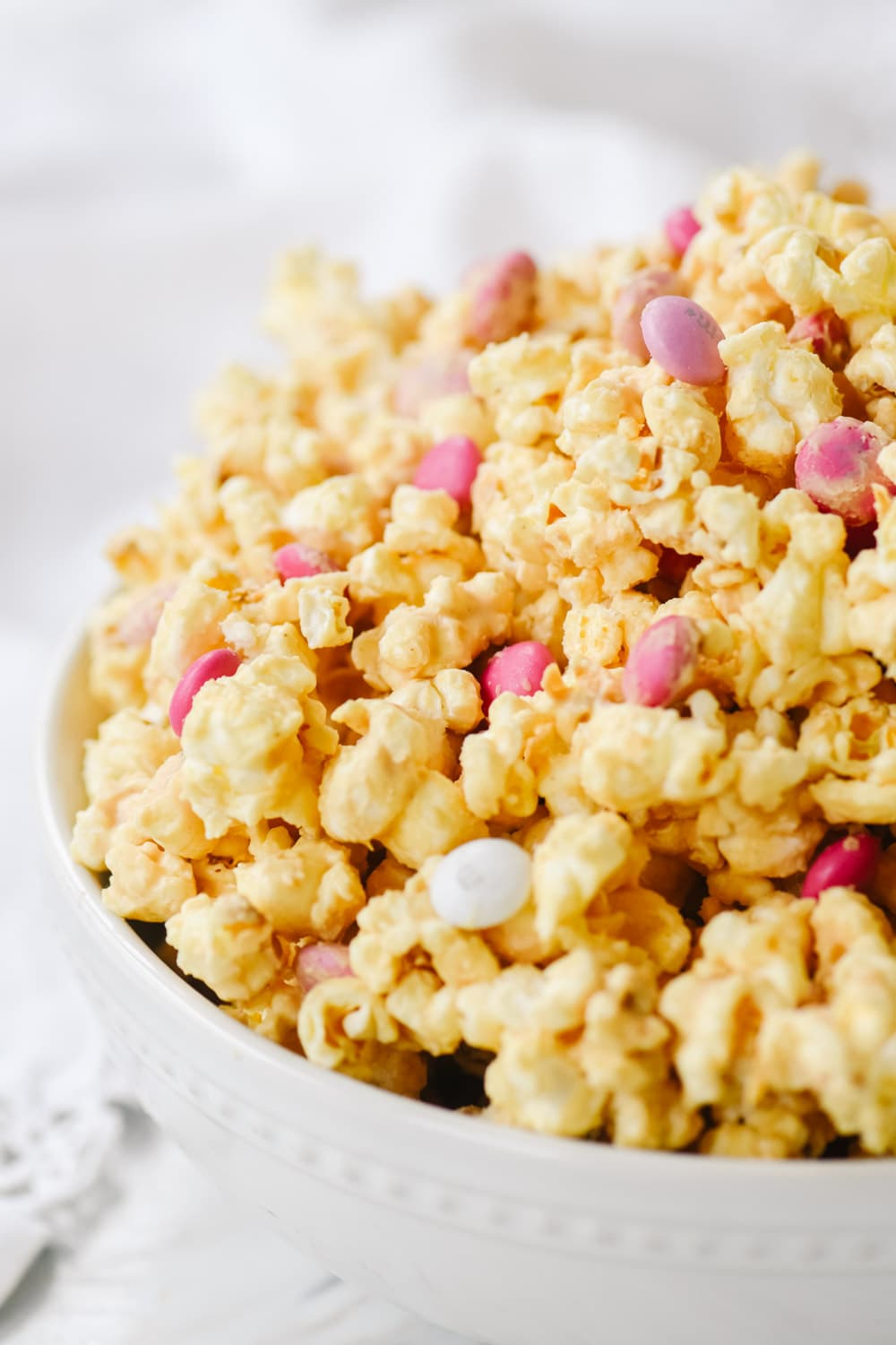 peanut butter popcorn in a white bowl