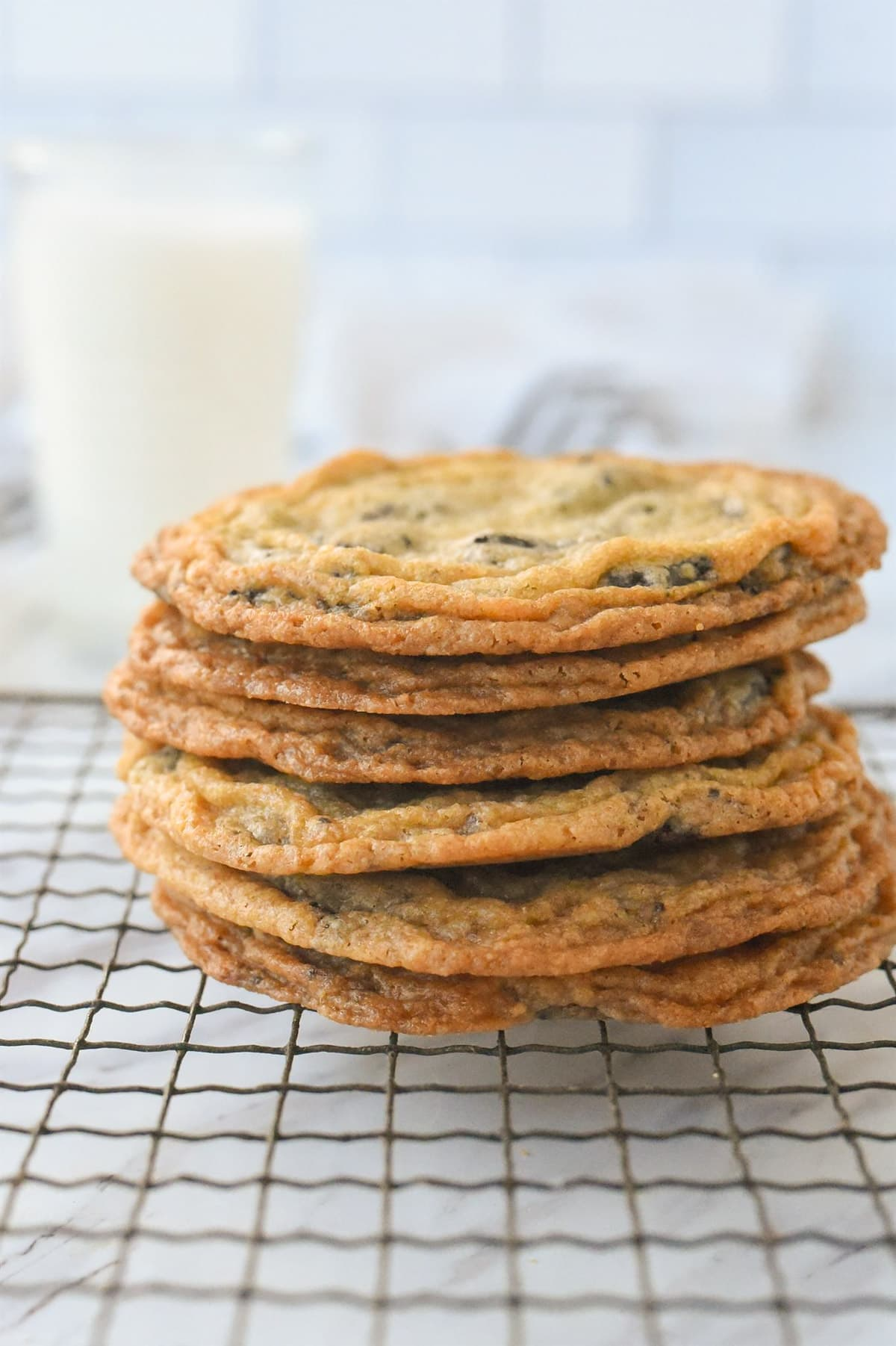 pile of cookies with a glass of milk