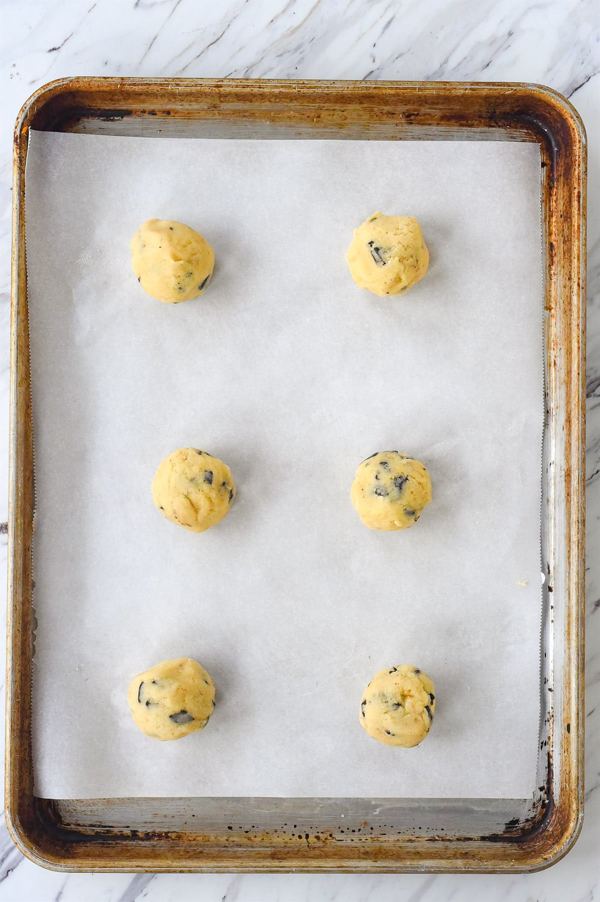 crinkle chocolate chip cookie dough on a baking sheet
