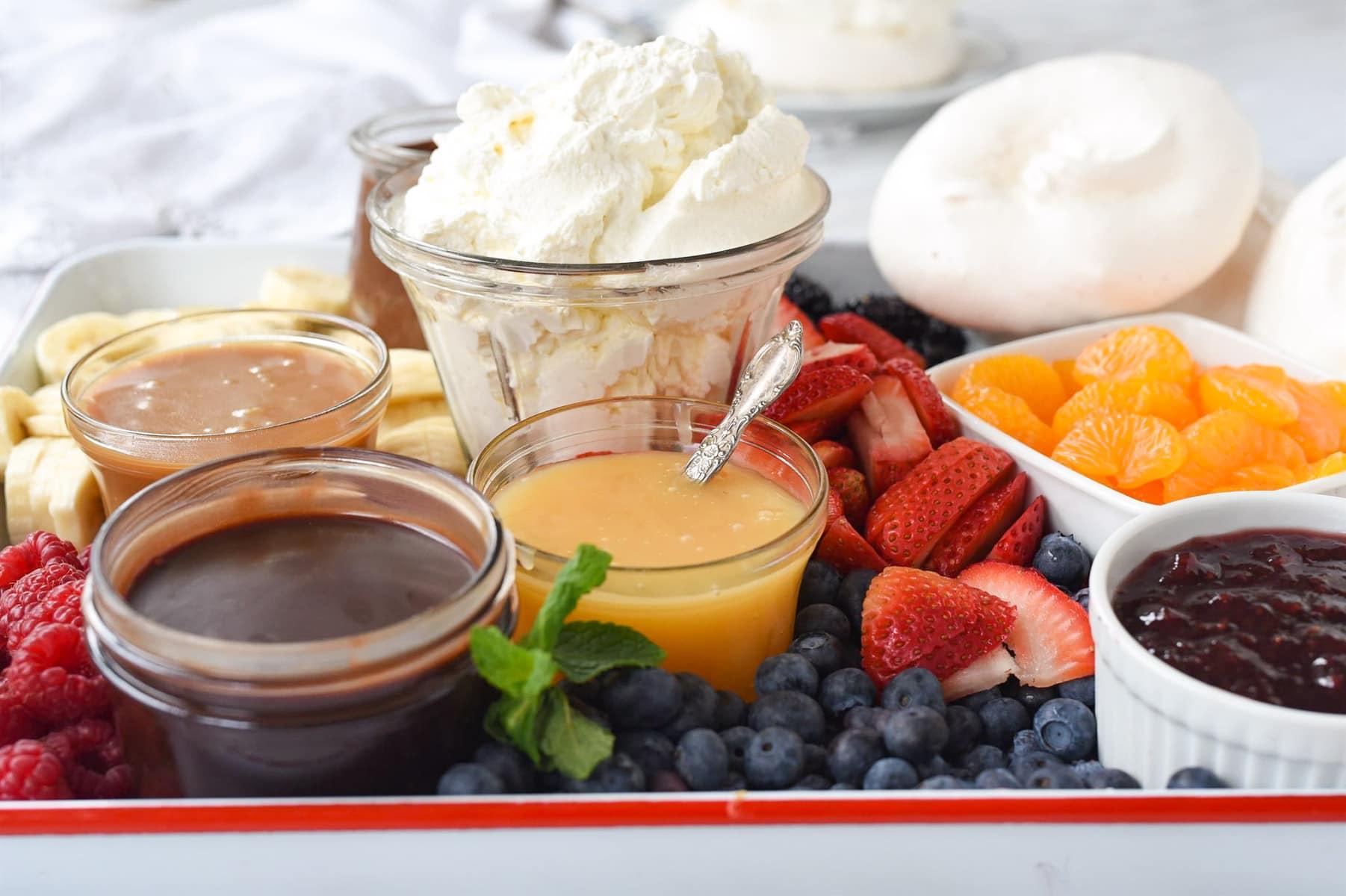 whipped cream on pavlova dessert board