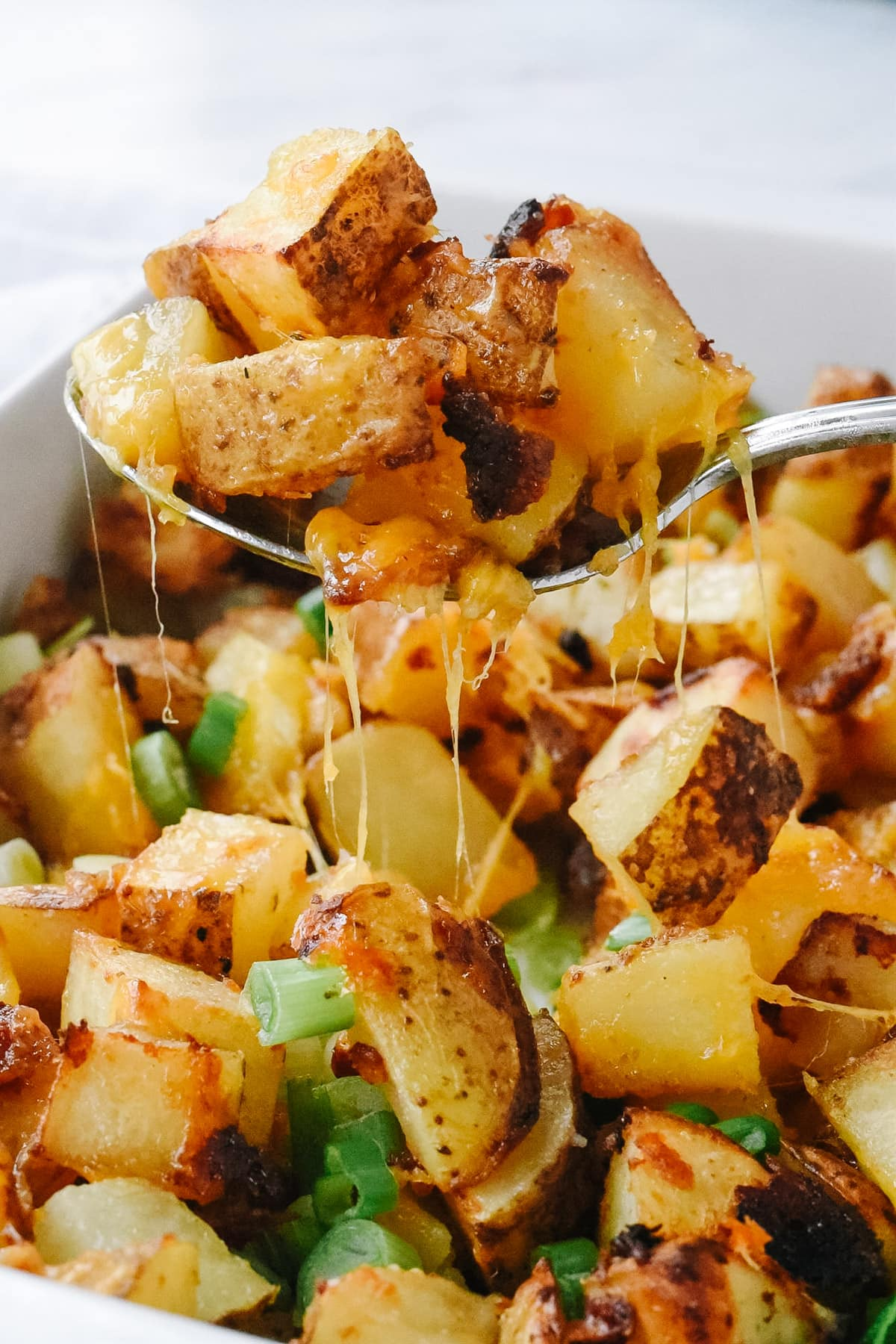 spoonful of roasted cheesy potatoes