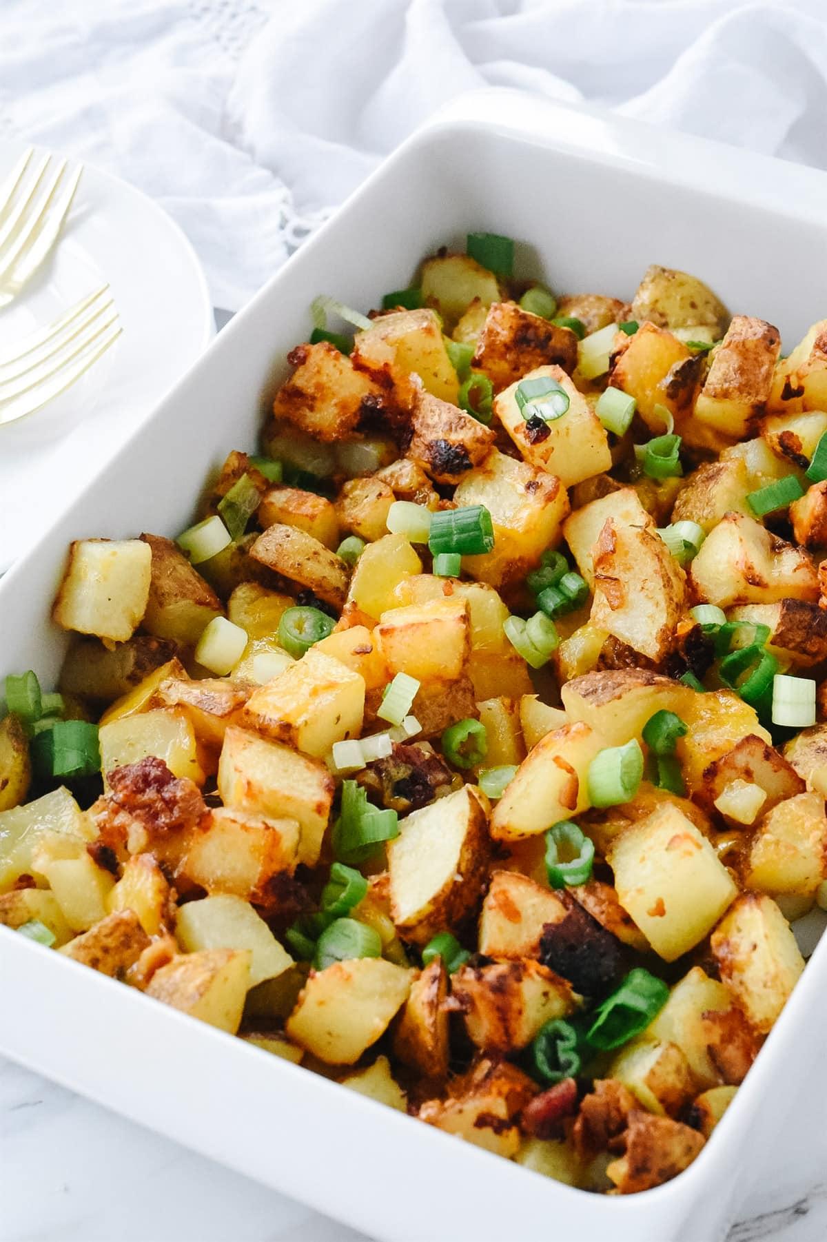 pan full of roasted bacon cheesy potatoes