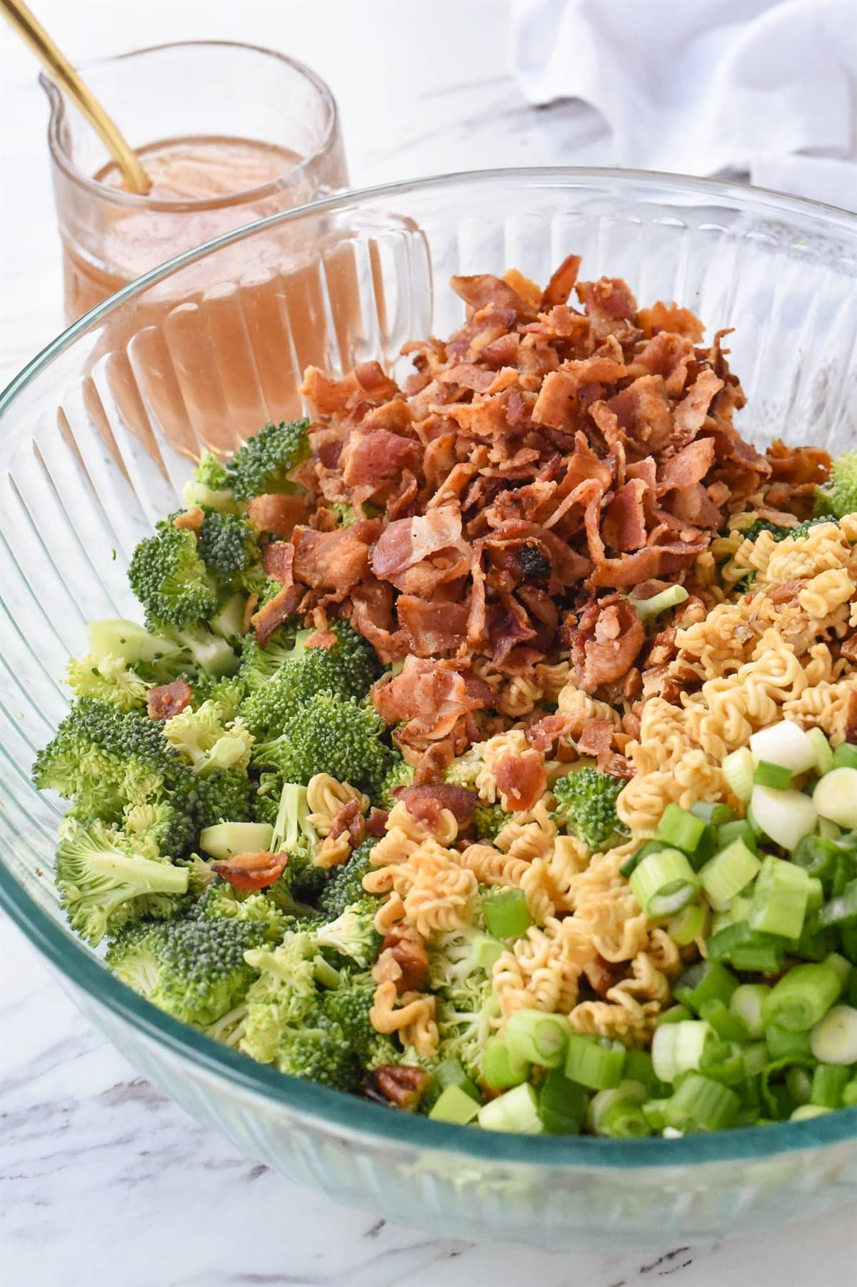 broccoli crunch salad ingredients in a bowl