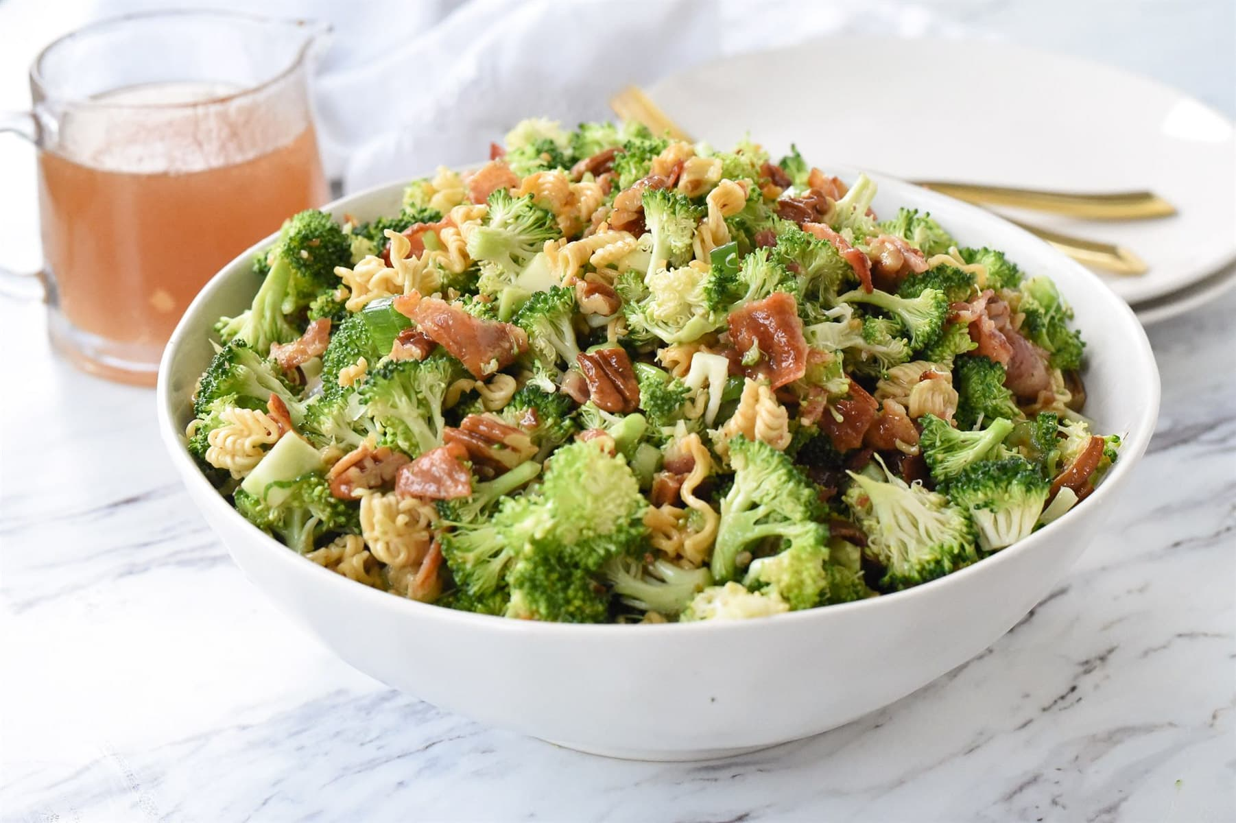 broccoli salad in a white bowl