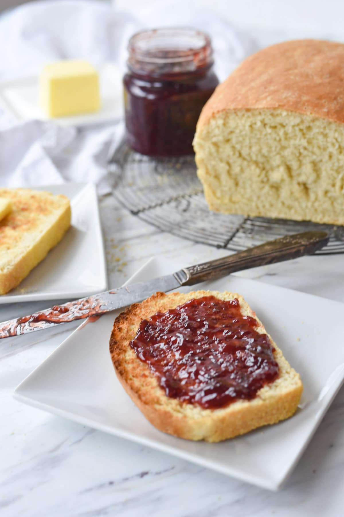 english muffin bread with jam on it