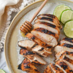 honey lime chicken with slices of lime