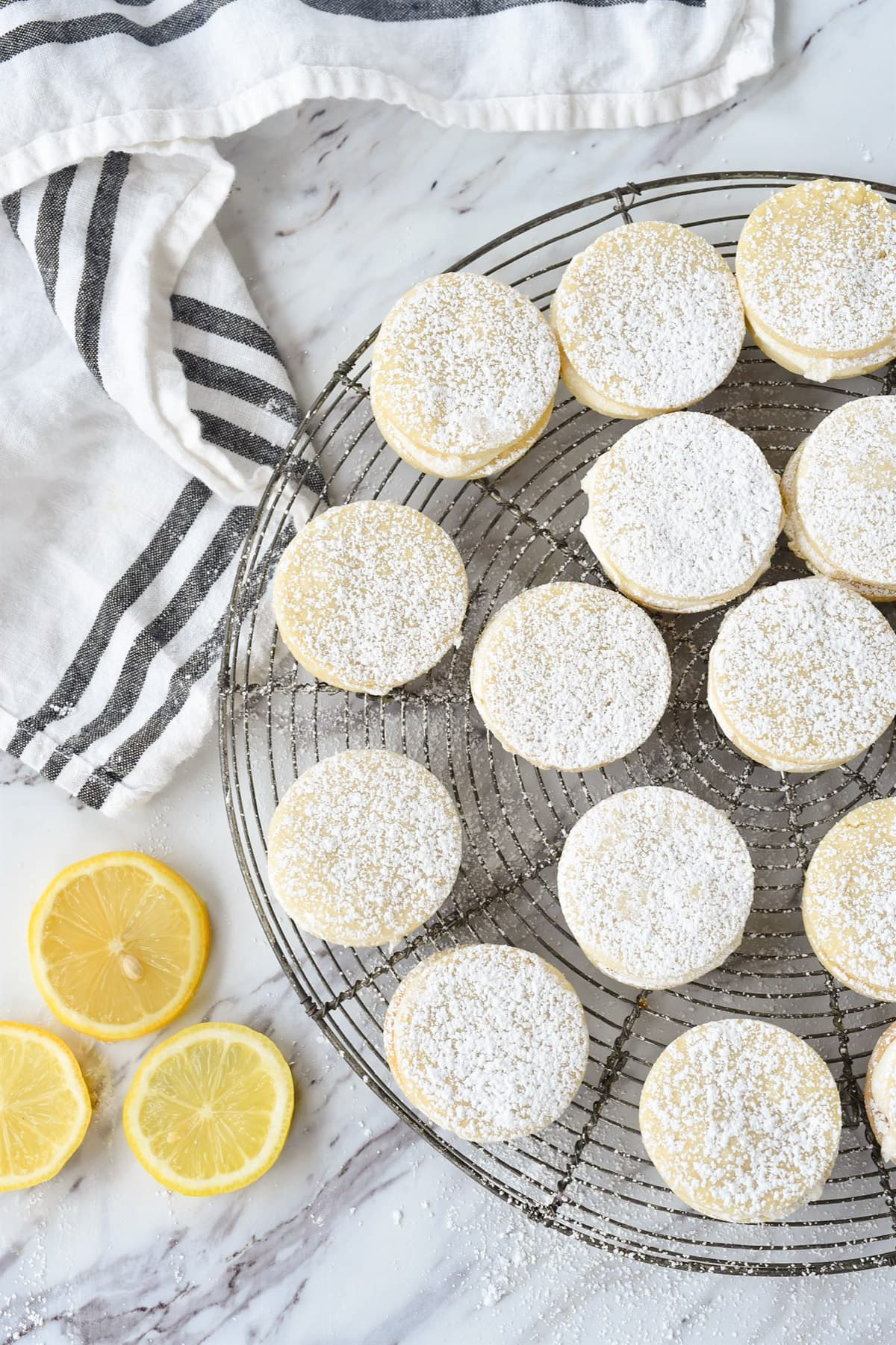 lemon dream cookies with powdered sugar on top