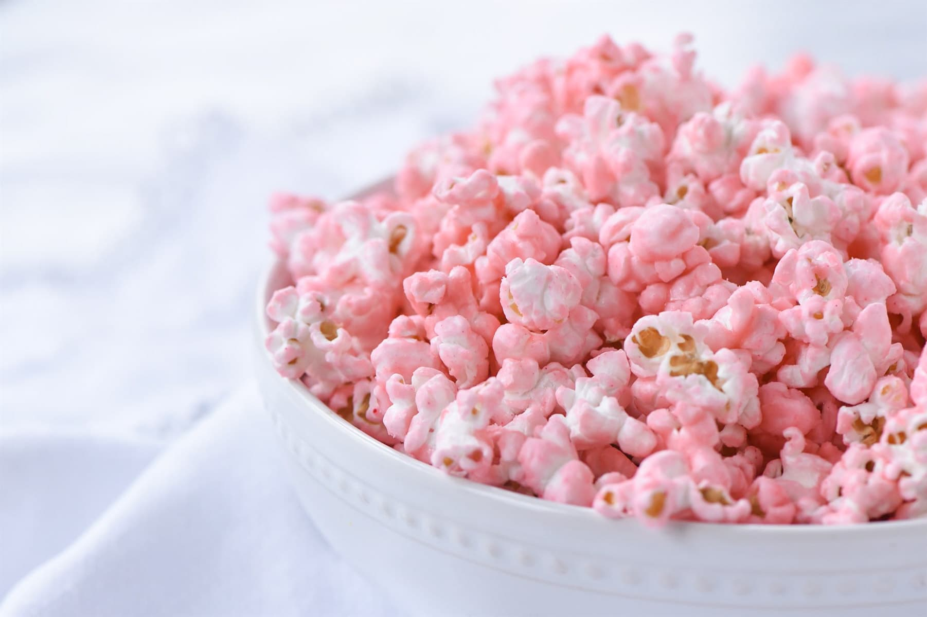 side view of a bowl of pink popcorn
