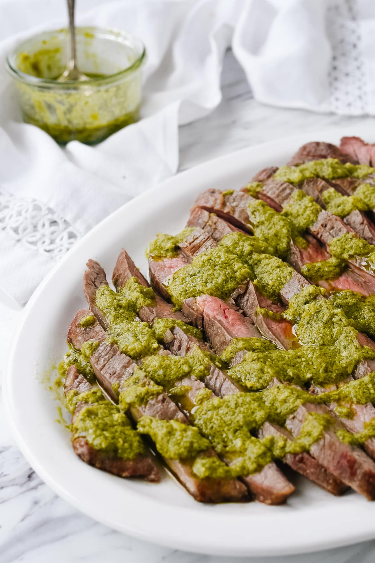 pesto drizzled over flank steak
