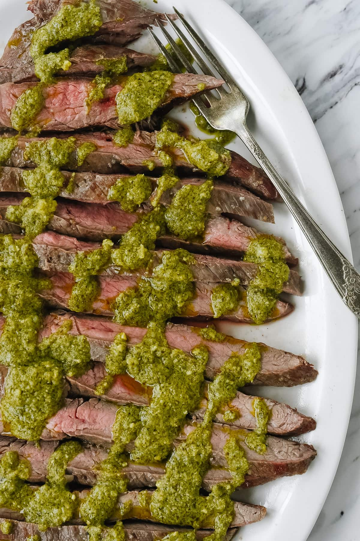 slices of pesto flank steak