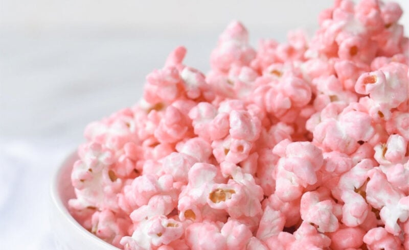 white bowl full of pink popcorn