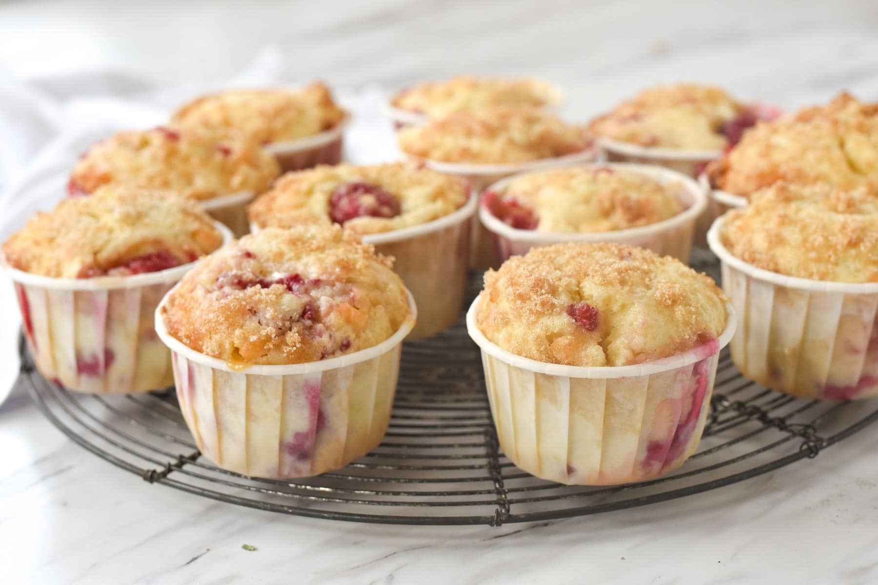 raspberry muffins in white wrappers