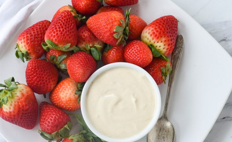 strawberries and brown sugar sour cream on a plate