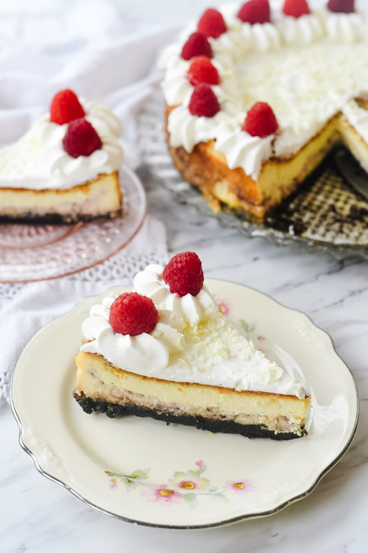 two slices of white chocolate raspberry cheesecake
